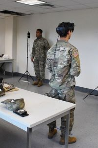Soldiers at Fort Benning take the temperature of trainees using sensors in a modified version of the IVAS googles. (Army)